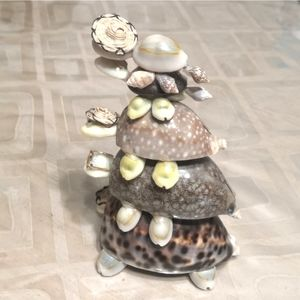 Stack of turtles made from clam shells
